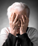 Old woman suffering from headache Royalty Free Stock Photography