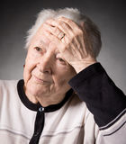 Old woman suffering from headache Royalty Free Stock Images