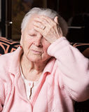Old woman suffering from headache Stock Photography