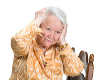 Old woman suffering from headache Stock Photos