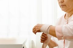 Old woman suffering from wrist hand pain, health problem concept royalty free stock photo