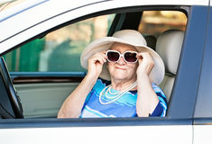 Old woman in sunglasses sitting in the car Stock Image