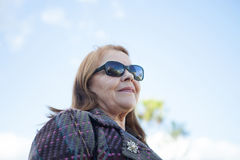 Old woman with sunglasses Stock Photography