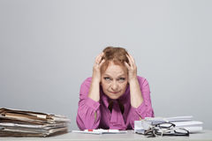 Old woman at the table with documents. Emotional Old woman at the table with documents stock photography