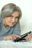 Old woman with tablet pc Stock Photography