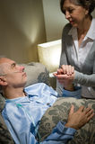 Old woman taking care of sick husband Royalty Free Stock Photography