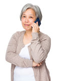 Old woman talk to mobile phone Stock Image