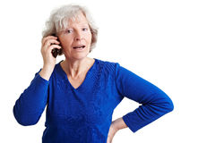Old woman talking in mobile phone Royalty Free Stock Images