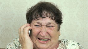 Old woman talking on the mobile phone stock footage