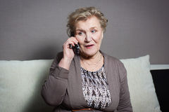 Old woman talking on the phone. Old woman talking on the house phone Royalty Free Stock Photo
