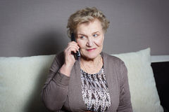 Old woman talking on the phone. Old woman talking on the house phone Royalty Free Stock Image