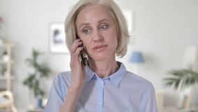 Old Woman Talking on Phone. 4k high quality, 4k high quality stock video