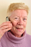 old woman is talking on a telephone Royalty Free Stock Photography