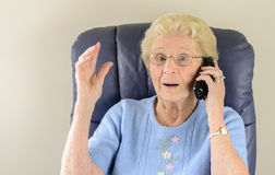Old Woman Talking on Telephone Royalty Free Stock Photography
