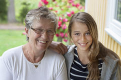 Old woman and teenager stock photos