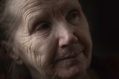 Old woman thinking in the dark Royalty Free Stock Images