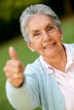Old woman with thumbs up Stock Photography