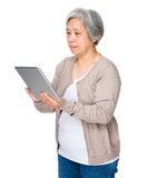 Old woman use of digital tablet Royalty Free Stock Photos