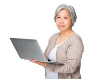 Old woman use of laptop Royalty Free Stock Photography