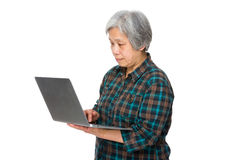Old woman use of notebook computer Stock Photography