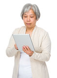 Old woman use of tablet Royalty Free Stock Photo