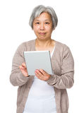 Old woman use of tablet Stock Photo