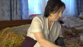 Old woman using blood pressure measurement tool on hand with electronic screen stock video footage