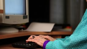 Old woman using computer. In room stock footage