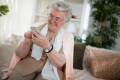 Old woman using a smartphone Stock Images