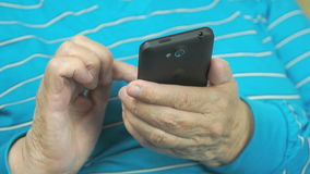 Old Woman Using Smartphone At Home. Close-up stock footage
