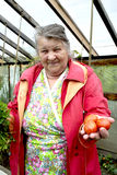 Old woman with vegetables Stock Photo