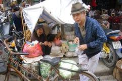 Old woman vendor on the sidewalk stock image
