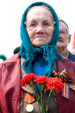 Old woman veteran of WWII. ULAN-UDE, RUSSIA - MAY 9: An unidentified elderly woman veteran of WWII watches at the parade on annual Victory Day, May, 9, 2009 in royalty free stock photos