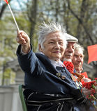 Old woman veteran of WWII. An unidentified elderly woman veteran of WWII watches at the parade on annual Victory Day, May, 9, 2013 stock photos