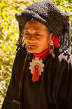 An old woman in Wa Ethnic Group Village. This is shot in a village called Weng'ding, located in southwest of Yunnan province. It's a Wa village. The Wa people Stock Photos