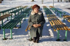 Old woman waiting for a man. Beautiful old woman on the bench in park Royalty Free Stock Photos
