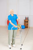Old woman with walker holding thumbs up Stock Photography