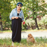 Old woman walking around city. Granny female outdoors Royalty Free Stock Photos