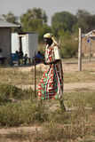 Old woman walking, Bor Sudan Stock Image