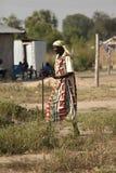 Old woman walking, Bor Sudan. Old woman walking with cane, Bor Sudan Stock Image