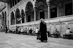 Old woman walking on a famous Istambul mosque Royalty Free Stock Image