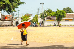 Old woman walking over square Royalty Free Stock Photo