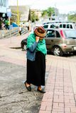 Old Woman walking in street of a city in Ecuador Stock Images