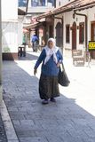The old woman walking in the street,Sarajevo. The old woman walking in the street is taken in Sarajevo Stock Image