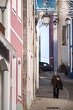Old woman walking in the street. 8th DECEMBER, 2017: MONCHIQUE, PORTUGAL - Old woman walking in the streets  of Monchique village, Portugal Royalty Free Stock Photo