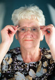 Old woman wearing glasses Stock Photos