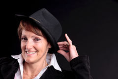 Old woman wearing a hat smiling Royalty Free Stock Photo