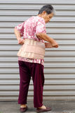 The old woman wearing a protection belt Stock Image