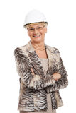 An old woman wearing a protective helmet. Royalty Free Stock Photos