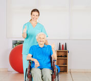 Old woman in wheelchair holding thumbs up Royalty Free Stock Photos